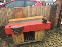 2 Heavy duty Wooden work bench with vices and storage underneath reclaimed from a high school
