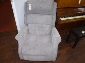 A sublime grey and black lift and rise recliner chair
