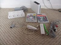 Nintendo Wii Bundle with games and charger console
