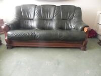 2 x 3 seater green leather sofas for sale.