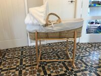 White Moses basket Clare de Lune. Comes with mattress, 2 x fitted sheets and two stands.