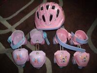 2 pairs overshoe roller skates (barbie and disney princess) plus helmet