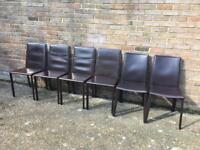Six brown dining chairs