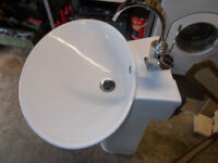 White Pedestal Sink.