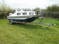 17ft dory hulled cabin boat with Mariner 50hp four stroke PTT on an galvanized Admiral trailer