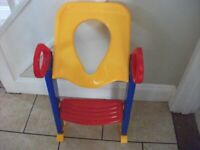 Toddler's toilet seat, colourful plastic