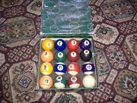 a set of pool 8 ball balls and set of snooker balls