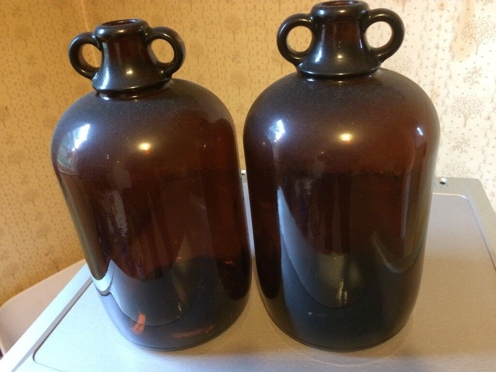 Two brown glass demijohns, wine making