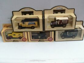 FIFTEEN BOXED LLEDO DIECAST DAYS GONE ADVERTISING VEHICLES PLUS DISPLAY CABINET