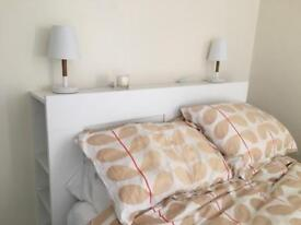 White IKEA double bed head with storage