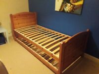 Solid Pine single bed with second pull out single bed underneath