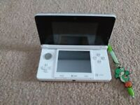 White Nintendo 3Ds console with 9 boxed games and case