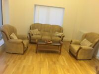 Sofa , two chairs and table in immaculate condition
