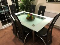 Stunning Glass Dining table with 6 chairs