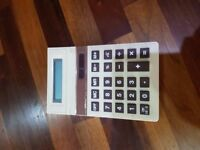 Small Desk Calculator with photo electric cell ie no batteries only light souce.