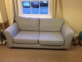 DFS sofa and pouffe with storage.