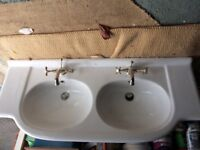 Double bathroom sink with taps
