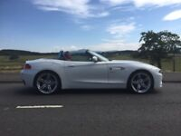Prestige White BMW Z4 Convertable with red Leather heated seats