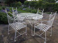 White wrought iron garden furniture set