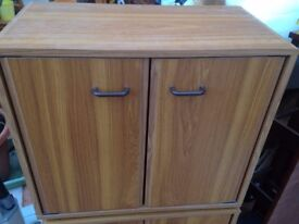 Wooden style Video Cabinet and it is Complete with about 65 Video Tapes