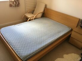 Stylish double IKEA Malm bed frame and mattress.