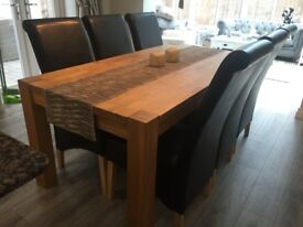 Solid Oak table and 6 oak black chairs, immaculate condition, legs can be removed for moving