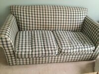 Used two-seater sofa - cushion covers washable, rest needs steam clean. Or good reupholster project.