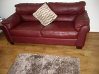 BURGUNDY 3 SEATER SETEE IN ITALIAN LEATHER PLUS MATCHING PUFFY LIKE NEW