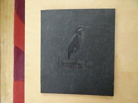 A slate etching of a Heron