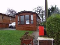 Cosalt Studio lodge (37x12 ft) for sale in Forest of Pendle leisure park, Roughlee, statics also