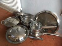 Three saucepans, tiered steamer, griddle, large wok / deep frying pan.