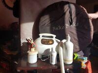 Fake bake spray tan equipment