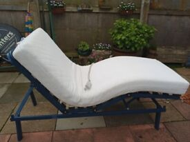 Good working order, clean mattress, washable cover, rises Bach and legs.