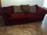 very large sofa in deep red with some cushions very good condition