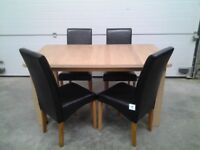 New Bargain. Extendable dining table and 4 black faux chairs. Boxed. Can deliver.