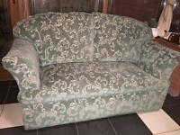 Drop down arm sofa