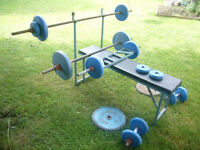 Weight bench, bars and 83 kg of assorted weights