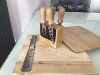Cheese boards and cheese cutting utensils