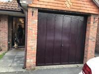 Garage door with frame