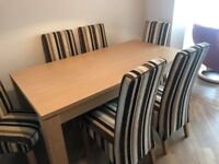 Extending 6 place oak dining table and fabric chairs