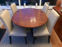 Dining Table Only - Antique wooden table with brass claw feet.