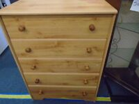 pine look chest of drawers.