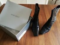 Nine West ladies short boot, size 7 in great condition (Black).