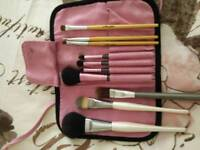 Make up brushes in roll bag