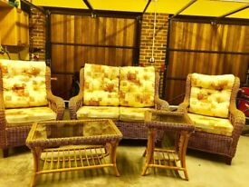 Cane Suite comprising of two seater sofa and two chairs. Plus two cane smoked glass coffee tables.