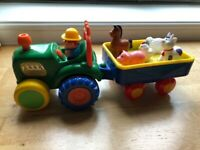 Toy tractor with trailer and animals
