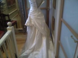 Ivory wedding dress with train size 8-10 by Champagne in good condition