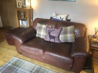 3 piece brown leather sofa/chair/ottoman set. Used but good condition