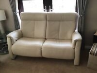 Leather 2 piece . Reclining settee and chair Rrp £2300. Hardly used