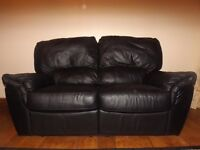 2 Seater leather reclining sofa and footstool, black leather £125